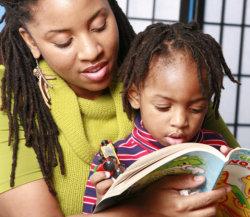 teacher and boy reading a book